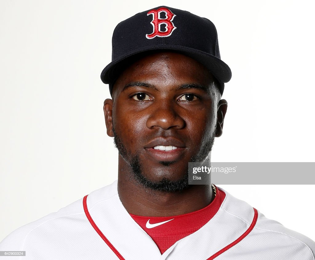 : Rusney Castillo #38 of the Boston Red Sox poses for a portrait during the Boston Red Sox photo day on February 19, 2017 at JetBlue Park in Ft. Myers, Florida.