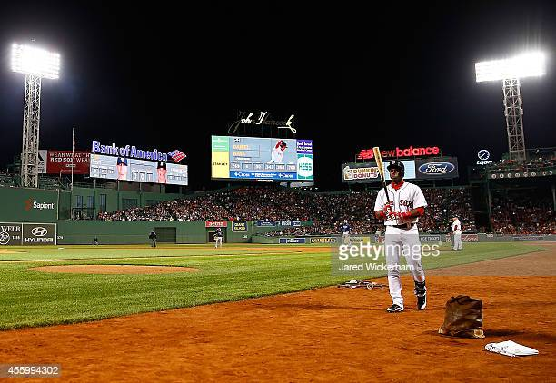 Rusney Castillo of the Boston Red Sox steps into the on deck circle in his first appearance at Fenway Park against the Tampa Bay Rays in the second...