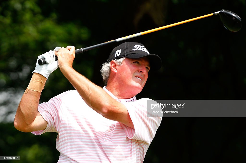 <a gi-track='captionPersonalityLinkClicked' href=/galleries/search?phrase=Russ+Cochran&family=editorial&specificpeople=3081168 ng-click='$event.stopPropagation()'>Russ Cochran</a> tees off on the 15th hole during the first round of the 2013 Constellation Senior Players Championship at Fox Chapel Golf Club on June 27, 2012 in Fox Chapel, Pennsylvania.