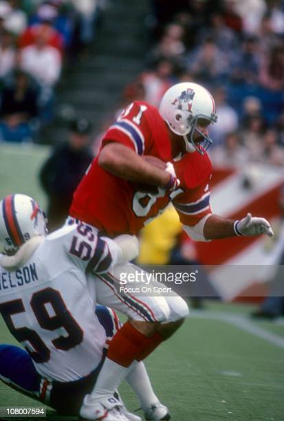 Russ Francis of the New England Patriots is tackled by Shane Nelson of the Buffal Bills during an NFL football game at Foxboro Stadium December 10...