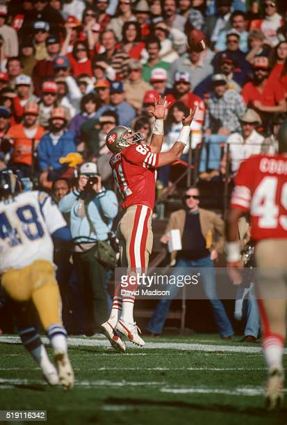 Russ Francis of the San Francisco 49ers attempts to catch a pass from quarterback Joe Montana during a National Football League game against the San...