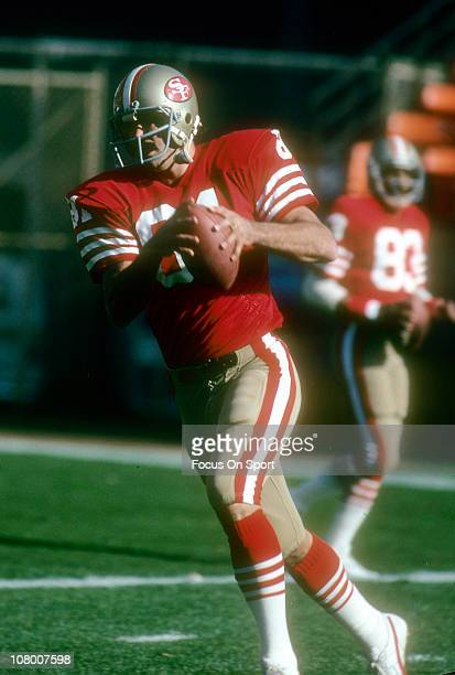 Russ Francis of the San Francisco 49ers catches a pass in pregame warmups before an NFL football game at Candlestick Park circa 1982 in San Francisco...