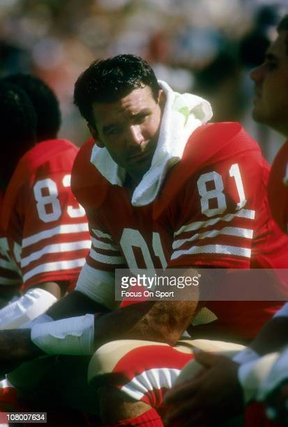 Russ Francis of the San Francisco 49ers talks with a teammate on the bench during an NFL football game at Candlestick Park circa 1983 in San...