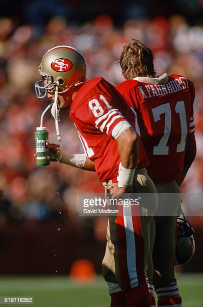 Russ Francis the San Francisco 49ers drinks on the sidelines during an NFL game played in November 1986 at Candlestick Park in San Francisco...