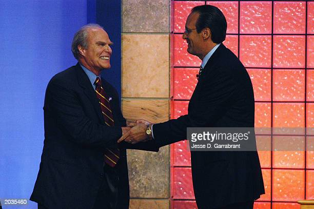 Russ Granik Deputy Commissioner of the NBA congratulates Gordon Gund owner of the Cleveland Cavaliers after winning the first overall pick during the...
