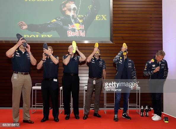 Russ Green Nigel Searle Matt Bergeron Bryan Milton all ExxonMobil enjoy a shoey with Daniel Ricciardo of Australia and Red Bull Racing during a show...