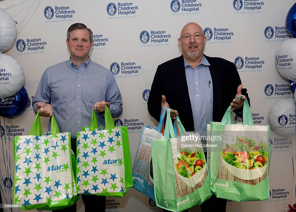 Russ Greenlaw, Director Of Operations, Star Market, and Paul Gossett, President, Shaw's Supermarkets, deliver healthy snacks to kids for the Shaw's & Star Market Give A Smile Kick-Off At Boston Children's Hospital May 31, 2016 in Boston, Massachusetts.