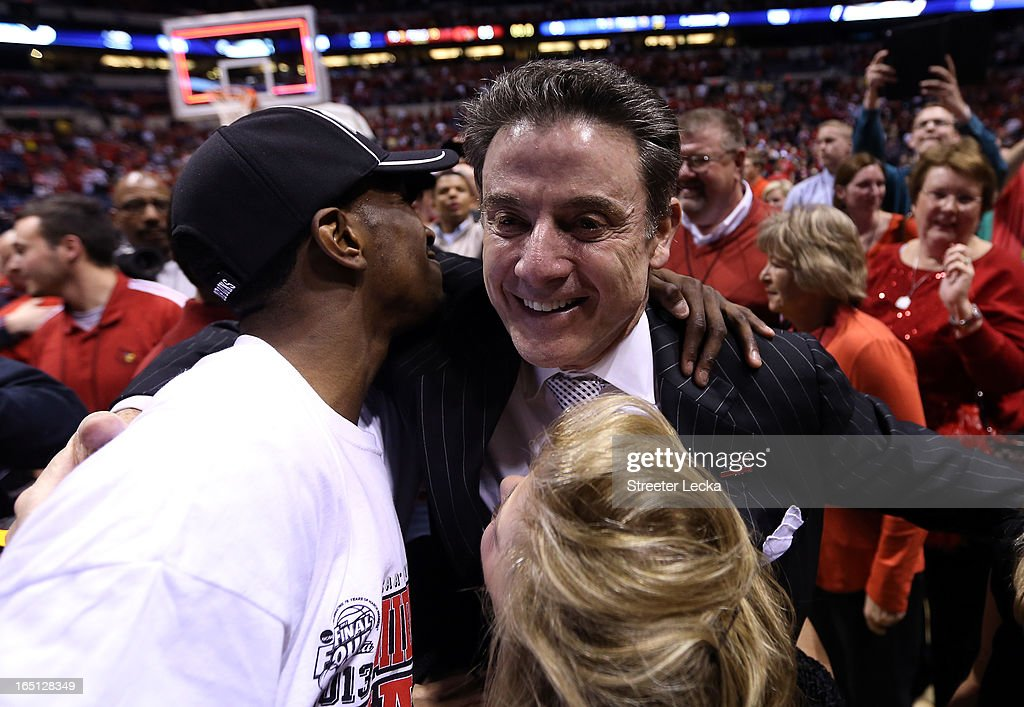 Russ Smith #2 and head coach Rick Pitino of the Louisville Cardinals celebrate after they won 85-63 against the Duke Blue Devils during the Midwest Regional Final round of the 2013 NCAA Men's Basketball Tournament at Lucas Oil Stadium on March 31, 2013 in Indianapolis, Indiana.