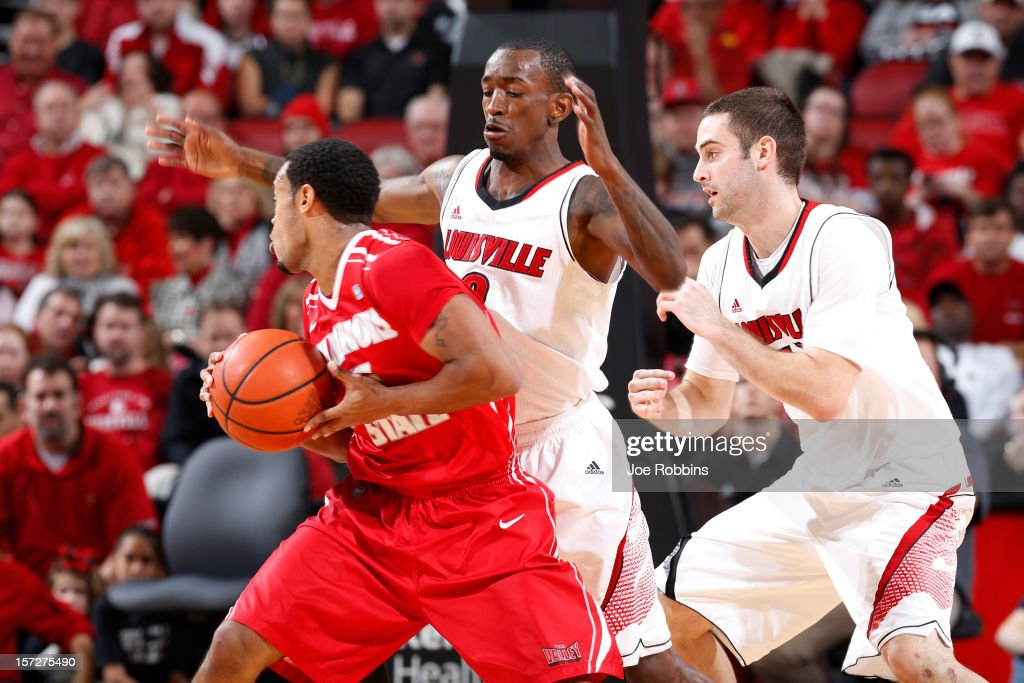 Russ Smith #2 and Luke Hancock #11 of the Louisville Cardinals defend against Anthony Cousin #5 of the Illinois State Redbirds during the game at KFC Yum! Center on December 1, 2012 in Louisville, Kentucky. Louisville won 69-66.
