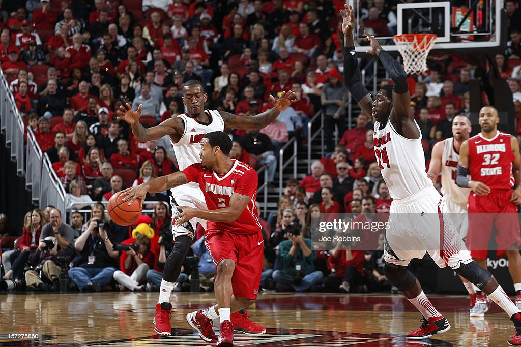 Russ Smith #2 and Montrezl Harrell #24 of the Louisville Cardinals defend against Anthony Cousin #5 of the Illinois State Redbirds during the game at KFC Yum! Center on December 1, 2012 in Louisville, Kentucky. Louisville won 69-66.