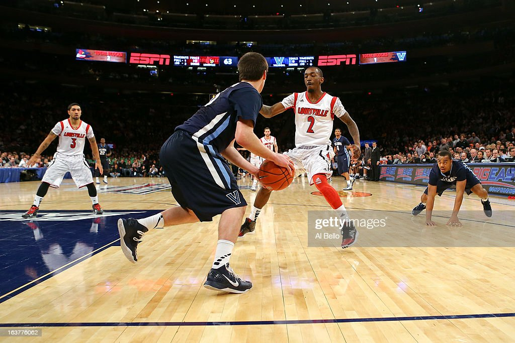 Russ Smith #2 and Peyton Siva #3 of the Louisville Cardinals apply the press on an inbounds play against Ryan Arcidiacono #15 of the Villanova Wildcats during the quaterfinals of the Big East Men's Basketball Tournament at Madison Square Garden on March 14, 2013 in New York City.