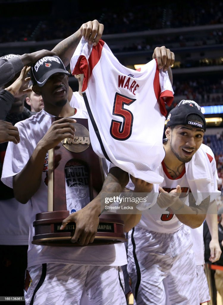 Russ Smith #2 and <a gi-track='captionPersonalityLinkClicked' href=/galleries/search?phrase=Peyton+Siva&family=editorial&specificpeople=5792001 ng-click='$event.stopPropagation()'>Peyton Siva</a> #3 of the Louisville Cardinals celebrate with the Midwest Regional CHampionship trophy as a teammate holds up a #5 jersey belonging to teammate Kevin Ware as they celebrate after they won 85-63 against the Duke Blue Devils during the Midwest Regional Final round of the 2013 NCAA Men's Basketball Tournament at Lucas Oil Stadium on March 31, 2013 in Indianapolis, Indiana. Ware suffered a compound fracture of his leg in the first half.