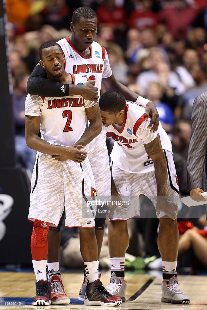 Russ Smith #2, Gorgui Dieng #10 and Chane Behanan #21 of the Louisville Cardinals react after Kevin Ware #5 suffered a compound fracture to his leg in the first half against the Duke Blue Devils during the Midwest Regional Final round of the 2013 NCAA Men's Basketball Tournament at Lucas Oil Stadium on March 31, 2013 in Indianapolis, Indiana.