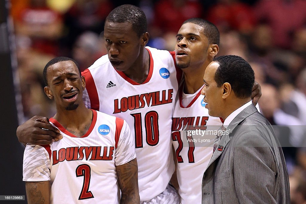 Russ Smith #2, Gorgui Dieng #10, Chane Behanan #21 and assitant coach Kevin Keatts of the Louisville Cardinals react after Kevin Ware #5 suffered a compound fracture to his leg in the first half against the Duke Blue Devils during the Midwest Regional Final round of the 2013 NCAA Men's Basketball Tournament at Lucas Oil Stadium on March 31, 2013 in Indianapolis, Indiana.