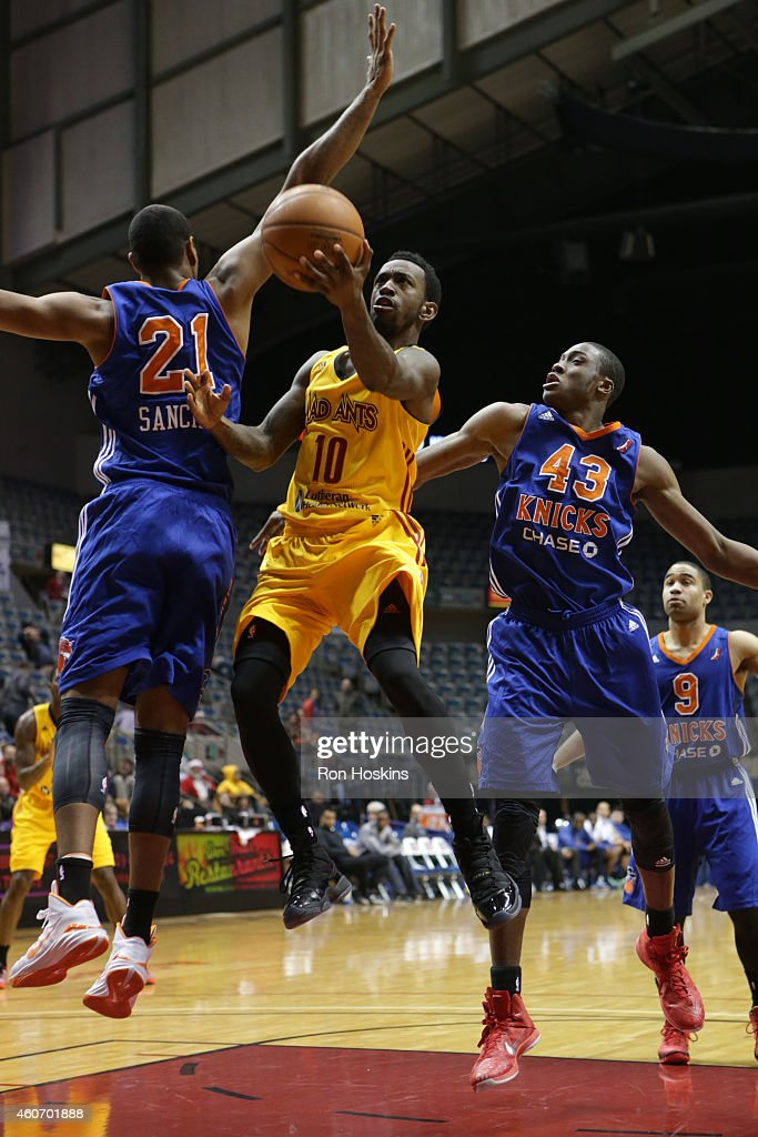 Russ Smith #10 of the Fort Wayne Mad Ants battles Orlando Sanchez #21 and Thanasis Antetokounmpo #43 of the Westchester Knicks during their NBDL game at Memorial Coliseum December 19, 2014 in Fort Wayne, Indiana.