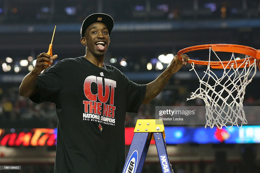 Russ Smith #2 of the Louisville Cardinals celebrates as he cuts down the net after they won 82-76 against the Michigan Wolverines during the 2013 NCAA Men's Final Four Championship at the Georgia Dome on April 8, 2013 in Atlanta, Georgia.