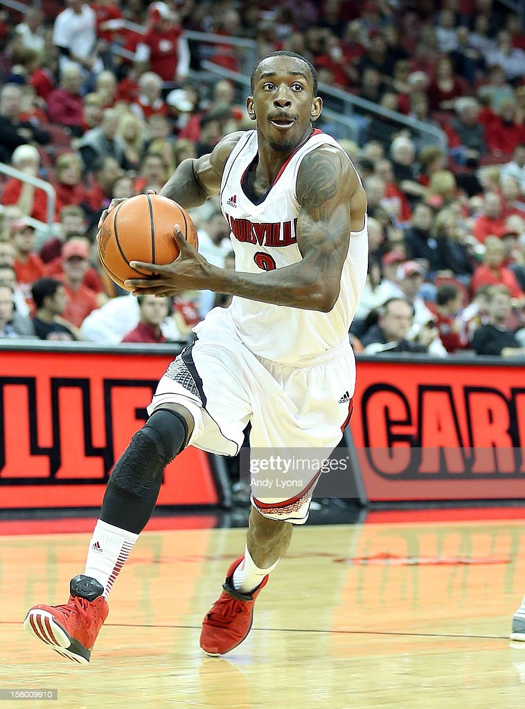 Russ Smith #2 of the Louisville Cardinals dribbles the ball during the game against the Missouri-Kansas City Kangaroos at KFC YUM! Center on December 8, 2012 in Louisville, Kentucky. Louisville won 99-47.