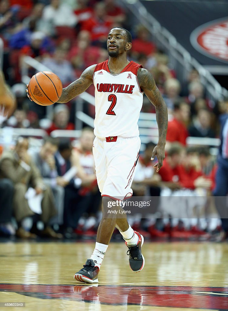 Russ Smith #2 of the Louisville Cardinals dribbles the ball during the game against the Missouri-Kansas City Kangaroos at KFC YUM! Center on December 4, 2013 in Louisville, Kentucky.