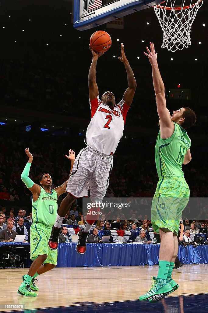 Russ Smith #2 of the Louisville Cardinals drives for a shot attempt in the second half against Garrick Sherman #11 of the Notre Dame Fighting Irish during the semifinals of the Big East Men's Basketball Tournament at Madison Square Garden on March 15, 2013 in New York City.