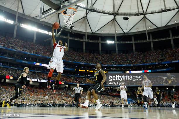 Russ Smith of the Louisville Cardinals drives for a shot attempt in the first half against the Wichita State Shockers during the 2013 NCAA Men's...