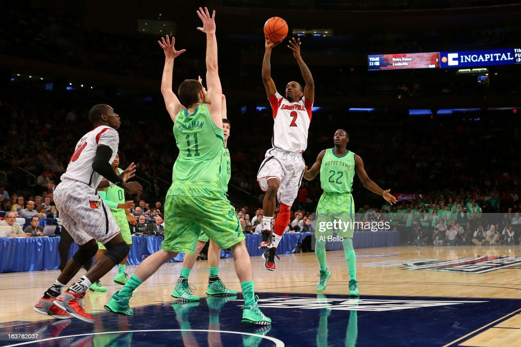 Russ Smith #2 of the Louisville Cardinals drives for a shot attempt against Garrick Sherman #11 of the Notre Dame Fighting Irish during the semifinals of the Big East Men's Basketball Tournament at Madison Square Garden on March 15, 2013 in New York City.
