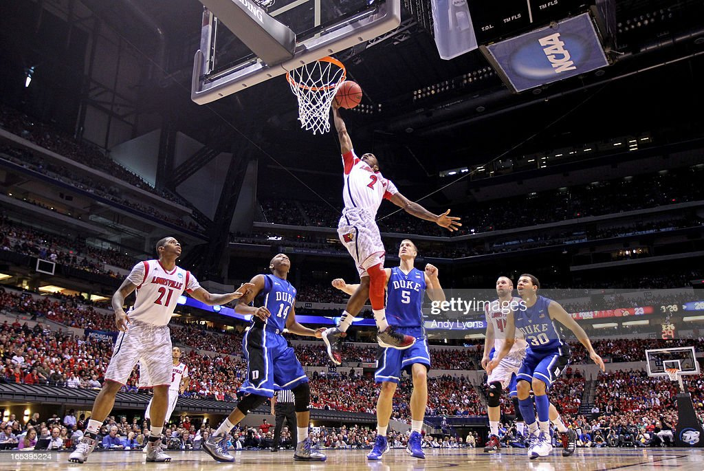 Russ Smith #2 of the Louisville Cardinals drives for a shot attempt against <a gi-track='captionPersonalityLinkClicked' href=/galleries/search?phrase=Rasheed+Sulaimon&family=editorial&specificpeople=7887134 ng-click='$event.stopPropagation()'>Rasheed Sulaimon</a> #14, <a gi-track='captionPersonalityLinkClicked' href=/galleries/search?phrase=Mason+Plumlee&family=editorial&specificpeople=5792012 ng-click='$event.stopPropagation()'>Mason Plumlee</a> #5 and <a gi-track='captionPersonalityLinkClicked' href=/galleries/search?phrase=Seth+Curry&family=editorial&specificpeople=5945068 ng-click='$event.stopPropagation()'>Seth Curry</a> #30 of the Duke Blue Devils during the Midwest Regional Final round of the 2013 NCAA Men's Basketball Tournament at Lucas Oil Stadium on March 31, 2013 in Indianapolis, Indiana. Louisville won 85-63.