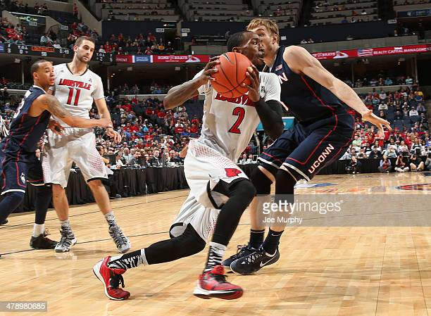 Russ Smith of the Louisville Cardinals drives the baseline against Niels Giffey of the Connecticut Huskies during the Championship of the American...