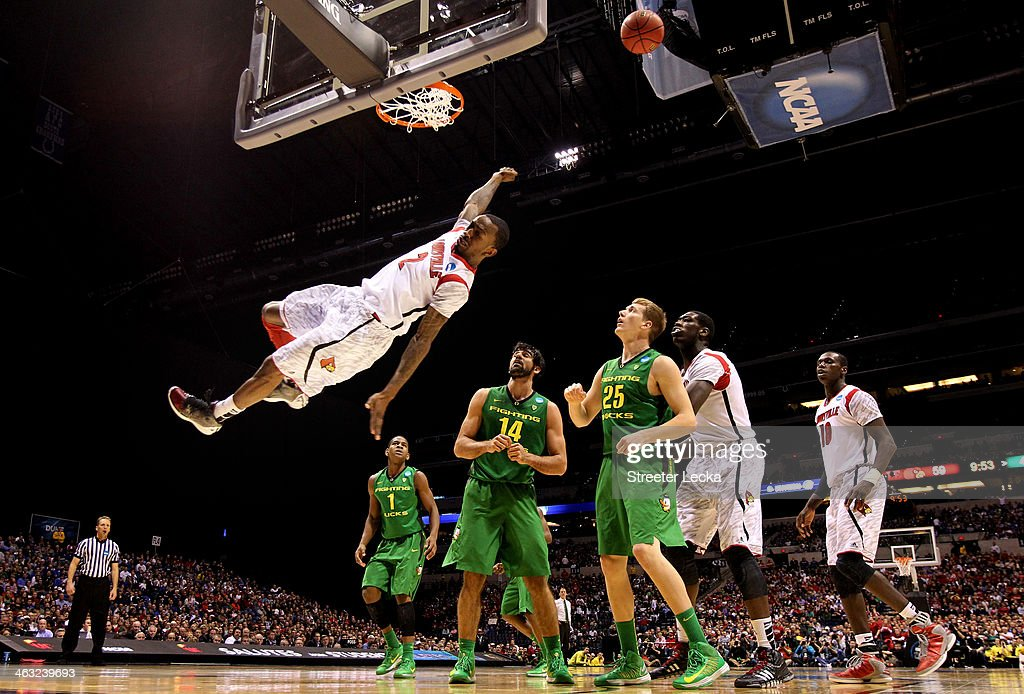 Russ Smith #2 of the Louisville Cardinals falls to the court afterhe missed a dunk attempt in the second half against the Oregon Ducks during the Midwest Region Semifinal round of the 2013 NCAA Men's Basketball Tournament at Lucas Oil Stadium on March 29, 2013 in Indianapolis, Indiana.