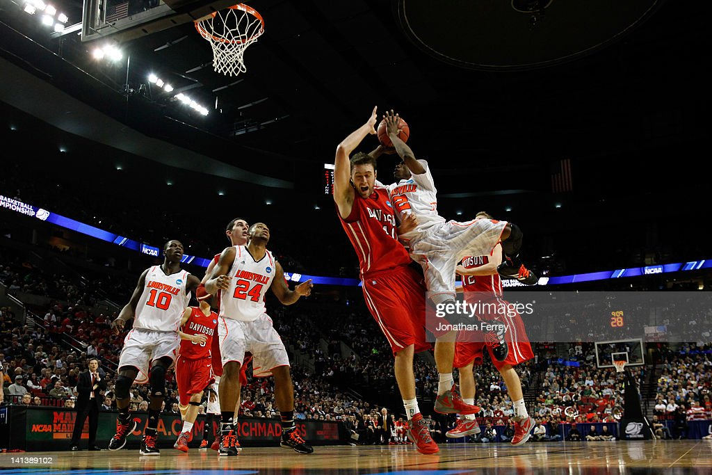 Russ Smith #2 of the Louisville Cardinals goes up for a shot against Clint Mann #40 of the Davidson Wildcats in the second half in the second round of the 2012 NCAA men's basketball tournament at Rose Garden Arena on March 15, 2012 in Portland, Oregon.