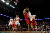 Russ Smith of the Louisville Cardinals goes up for a shot against Clint Mann of the Davidson Wildcats in the second half in the second round of the...