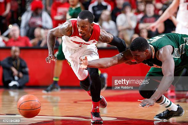 Russ Smith of the Louisville Cardinals knocks the ball away from John Egbunu of the South Florida Bulls during the game at KFC Yum Center on February...