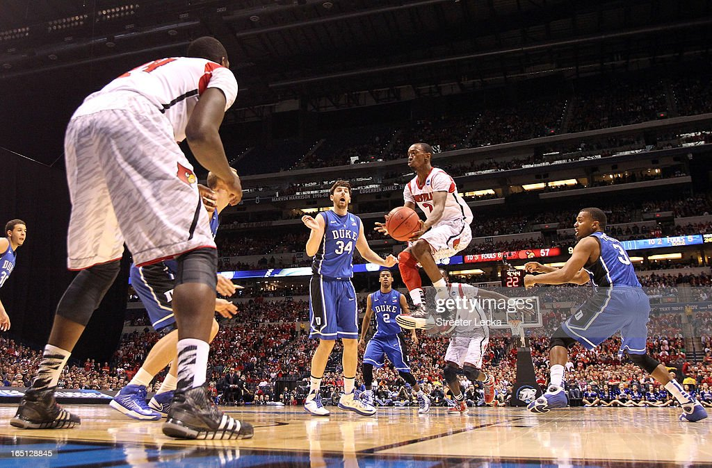 Russ Smith #2 of the Louisville Cardinals looks to pass as he drives against the Duke Blue Devils during the Midwest Regional Final round of the 2013 NCAA Men's Basketball Tournament at Lucas Oil Stadium on March 31, 2013 in Indianapolis, Indiana.