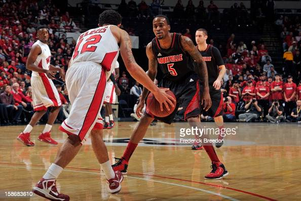 Russ Smith of the Louisville Cardinals plays against Brandon Harris of the Western Kentucky Hilltoppers at Bridgestone Arena on December 22 2012 in...