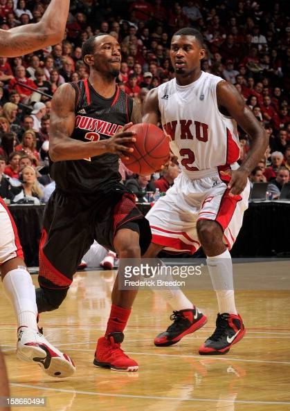 Russ Smith of the Louisville Cardinals plays against Eddie Alcantara of the Western Kentucky Hilltoppers at Bridgestone Arena on December 22 2012 in...