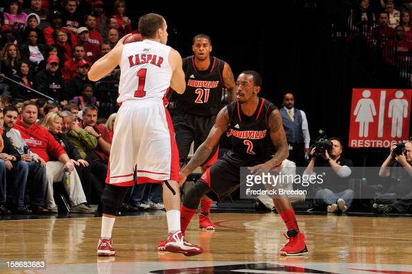 Russ Smith of the Louisville Cardinals plays against Kevin Kaspar of the Western Kentucky Hilltoppers at Bridgestone Arena on December 22 2012 in...