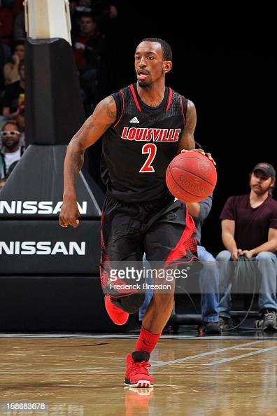 Russ Smith of the Louisville Cardinals plays against of the Western Kentucky Hilltoppers at Bridgestone Arena on December 22 2012 in Nashville...