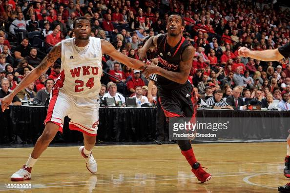 Russ Smith of the Louisville Cardinals plays against Stephon Drane of the Western Kentucky Hilltoppers at Bridgestone Arena on December 22 2012 in...