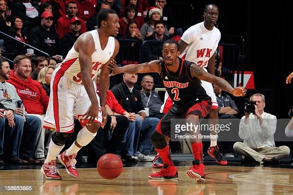 Russ Smith of the Louisville Cardinals plays against TJ Price of the Western Kentucky Hilltoppers at Bridgestone Arena on December 22 2012 in...