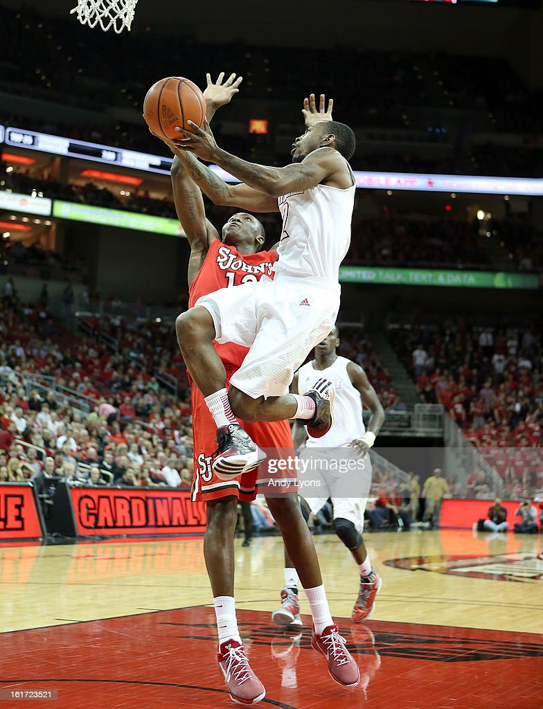 Russ Smith #2 of the Louisville Cardinals shoots the ball during the game against the St. John's Red Storm at KFC YUM! Center on February 14, 2013 in Louisville, Kentucky.