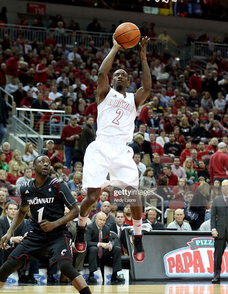 Russ Smith #2 of the Louisville Cardinals shoots the ball during the game against the Cincinnati Bearcats at KFC YUM! Center on March 4, 2013 in Louisville, Kentucky.