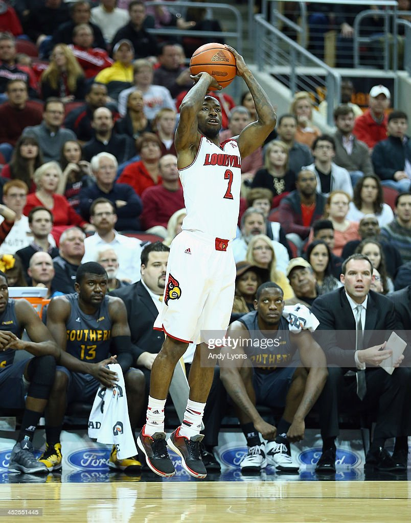 Russ Smith #2 of the Louisville Cardinals shoots the ball during the game against the Southern Mississippi Golden Eagles at KFC YUM! Center on November 29, 2013 in Louisville, Kentucky.