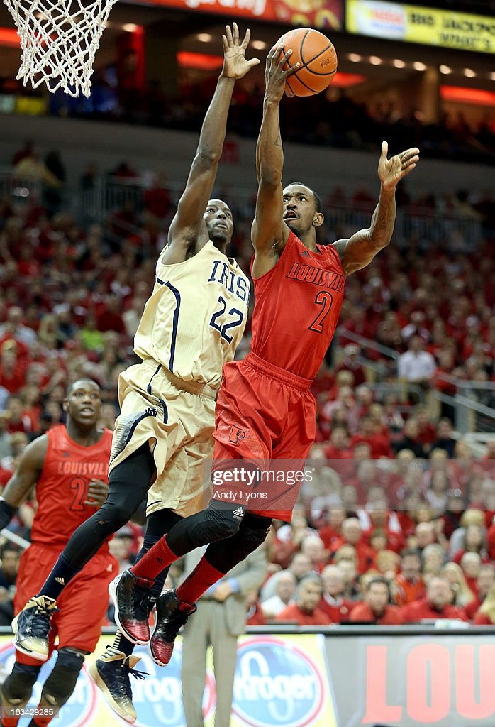 Russ Smith #2 of the Louisville Cardinals shoots the ball while defended by Jerian Grant #22 of the Notre Dame Fighting Irish at KFC YUM! Center on March 9, 2013 in Louisville, Kentucky.