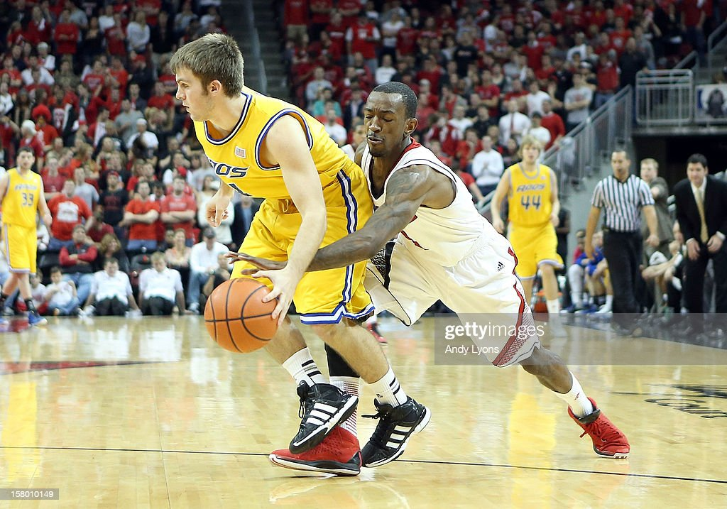 Russ Smith #2 of the Louisville Cardinals steals the ball from Mason Wedel #4 of the Missouri-Kansas City Kangaroos during the game at KFC YUM! Center on December 8, 2012 in Louisville, Kentucky.