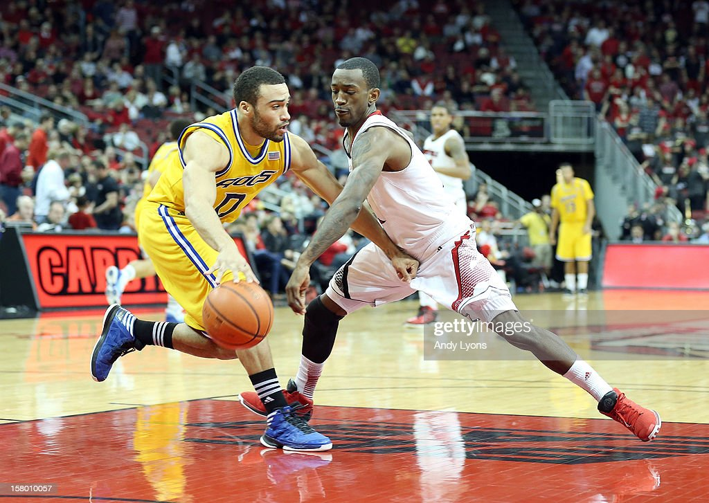 Russ Smith #2 of the Louisville Cardinals steals the ball from Nate Rogers #0 of the Missouri-Kansas City Kangaroos during the game at KFC YUM! Center on December 8, 2012 in Louisville, Kentucky.