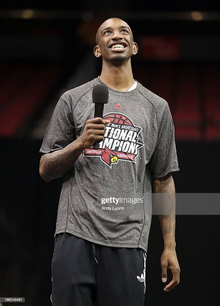 Russ Smith of the Louisville Cardinals talks during the Louisville Cardinals NCAA Basketball Celebration to mark the NCAA championship by the Mens team and the runner-up finish by the womens team at KFC YUM! Center on April 10, 2013 in Louisville, Kentucky.