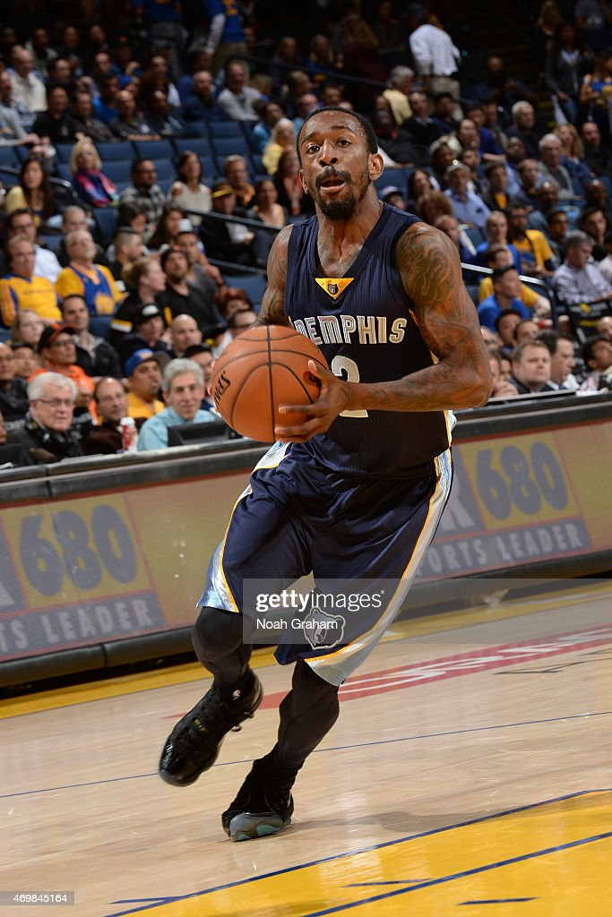 Russ Smith #2 of the Memphis Grizzlies drives against the Golden State Warriors during the game on April 13, 2015 at Oracle Arena in Oakland, California.