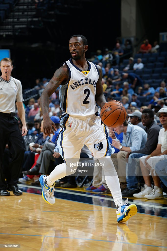 <a gi-track='captionPersonalityLinkClicked' href=/galleries/search?phrase=Russ+Smith+-+Basketballer&family=editorial&specificpeople=10584261 ng-click='$event.stopPropagation()'>Russ Smith</a> #2 of the Memphis Grizzlies handles the ball against the Houston Rockets during a preseason game on October 6, 2015 at FedExForum in Memphis, Tennessee.