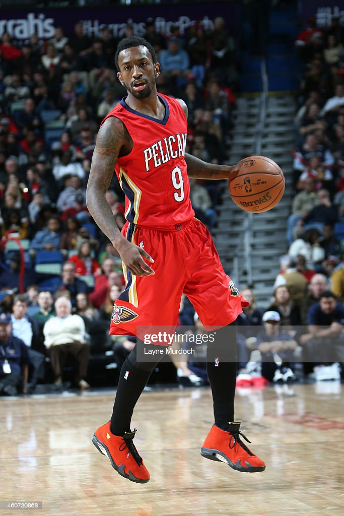 <a gi-track='captionPersonalityLinkClicked' href=/galleries/search?phrase=Russ+Smith+-+Basketballer&family=editorial&specificpeople=10584261 ng-click='$event.stopPropagation()'>Russ Smith</a> #9 of the New Orleans Pelicans handles the ball against the Portland Trail Blazers on December 20, 2014 at Smoothie King Center in New Orleans, LA.