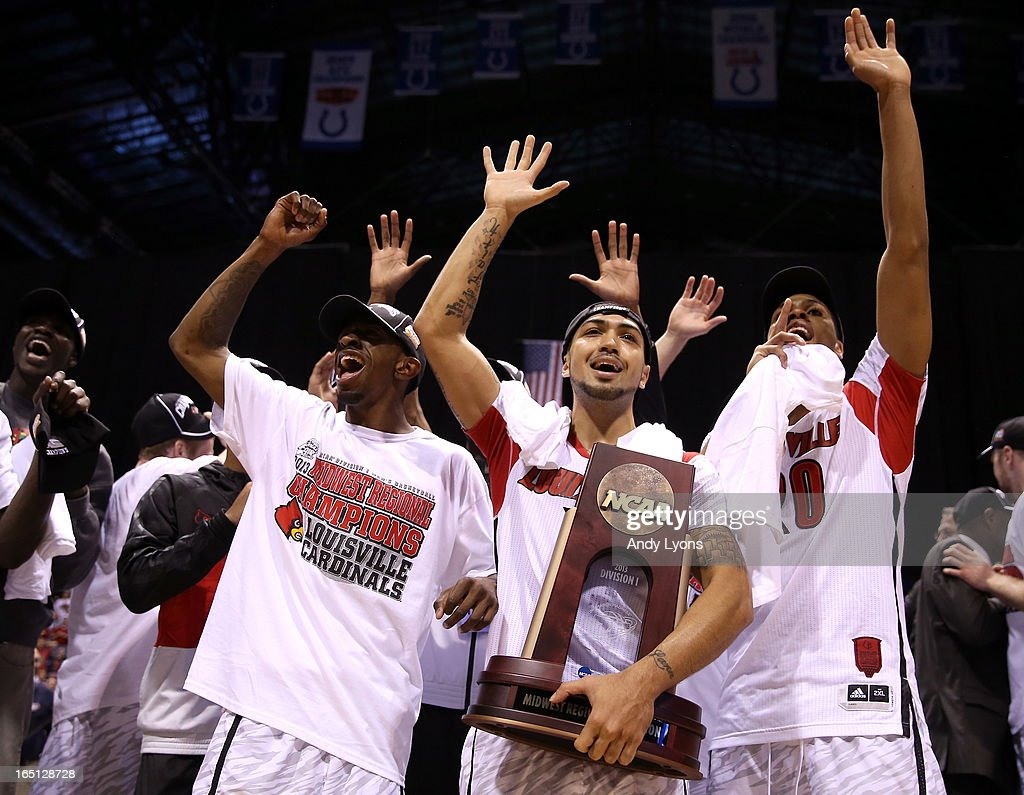 Russ Smith #2 , Peyton Siva #3 and Wayne Blackshear #20 of the Louisville Cardinals celebrate with the Midwest Regional Championship trophy after they won 85-63 against the Duke Blue Devils during the Midwest Regional Final round of the 2013 NCAA Men's Basketball Tournament at Lucas Oil Stadium on March 31, 2013 in Indianapolis, Indiana.