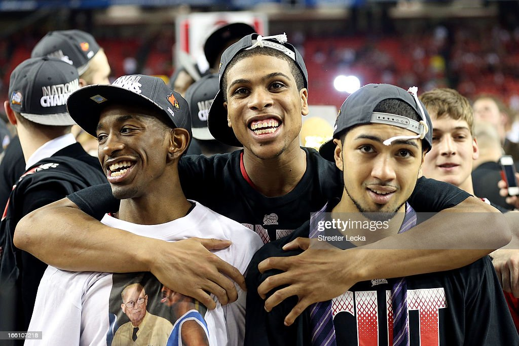 Russ Smith #2, Wayne Blackshear #20 and <a gi-track='captionPersonalityLinkClicked' href=/galleries/search?phrase=Peyton+Siva&family=editorial&specificpeople=5792001 ng-click='$event.stopPropagation()'>Peyton Siva</a> #3 of the Louisville Cardinals celebrate after they won 82-76 against the Michigan Wolverines during the 2013 NCAA Men's Final Four Championship at the Georgia Dome on April 8, 2013 in Atlanta, Georgia.